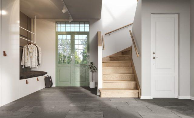 Inbyggd, tät trappa med sidovang.